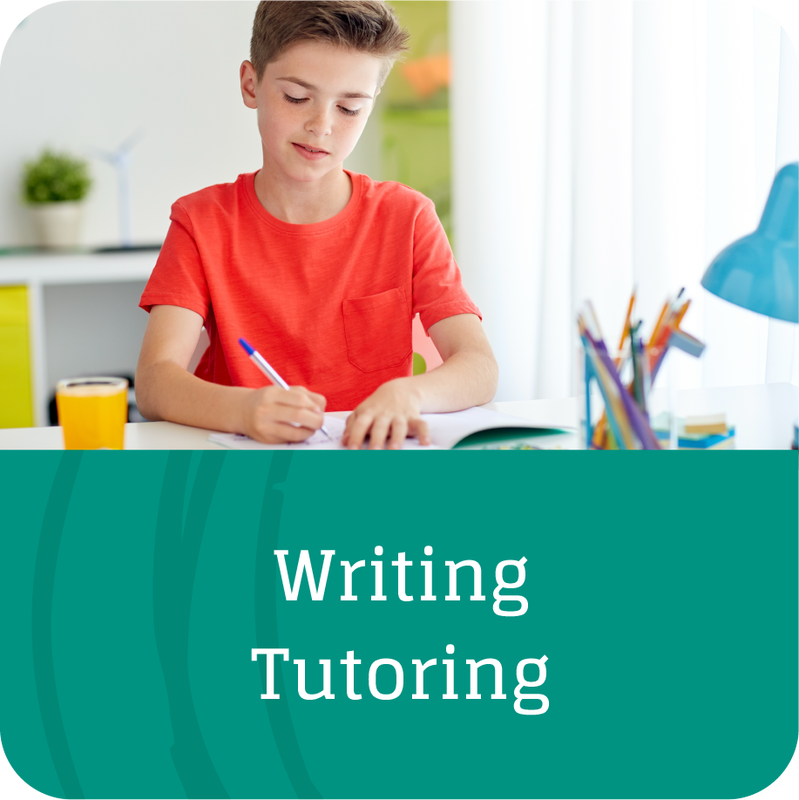 boy practicing writing skills learned in tutoring